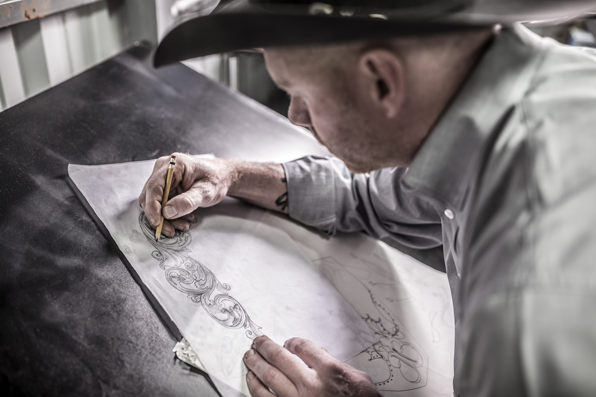 JW Brooks sketching out a custom hat design